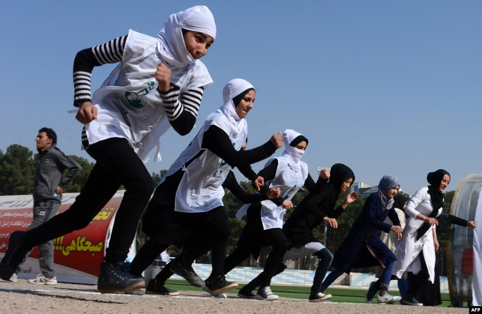 Afghan schoolgirls take part in a running race held for a peace initiative in the western Herat Province. (AFP/Aref Karimi)