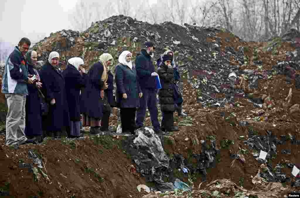 Women from Srebrenica cry during the exhumation of a mass grave believed to hold the bodies of massacre victims from the 1992-1995 war in Bosnia-Herzegovina, near the eastern town of Zvornik, on December 15.
