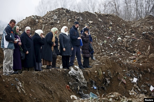 "Women from Srebrenica cry during the exhumation in December 1995 of a mass grave believed to hold the bodies of victims who were massacred in the UN-designated ""safe haven"" during the Bosnian war."