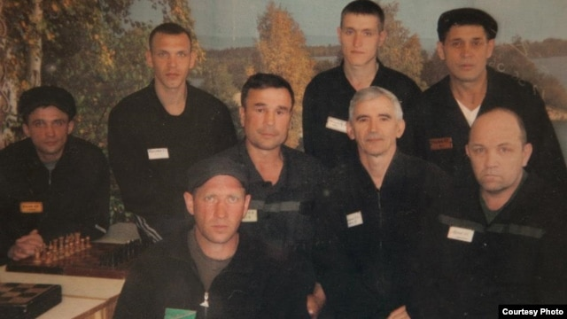 Valentin Danilov (middle row, second from right) and other inmates in their Siberian prison (undated)