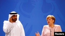 German Chancellor Angela Merkel and Abu Dhabi's Crown Prince Mohammed bin Zayed al Nahyan attend a news conference at the Chancellery in Berlin, Germany, June 12, 2019. REUTERS/Hannibal Hanschke