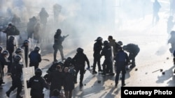 Kosovo-Albanian protesters clash with police near the Serbian border.