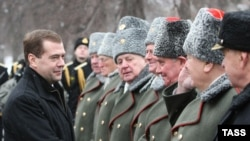 President Dmitry Medvedev (left) attends a wreath-laying ceremony at the Tomb of the Unknown Soldier in Moscow.