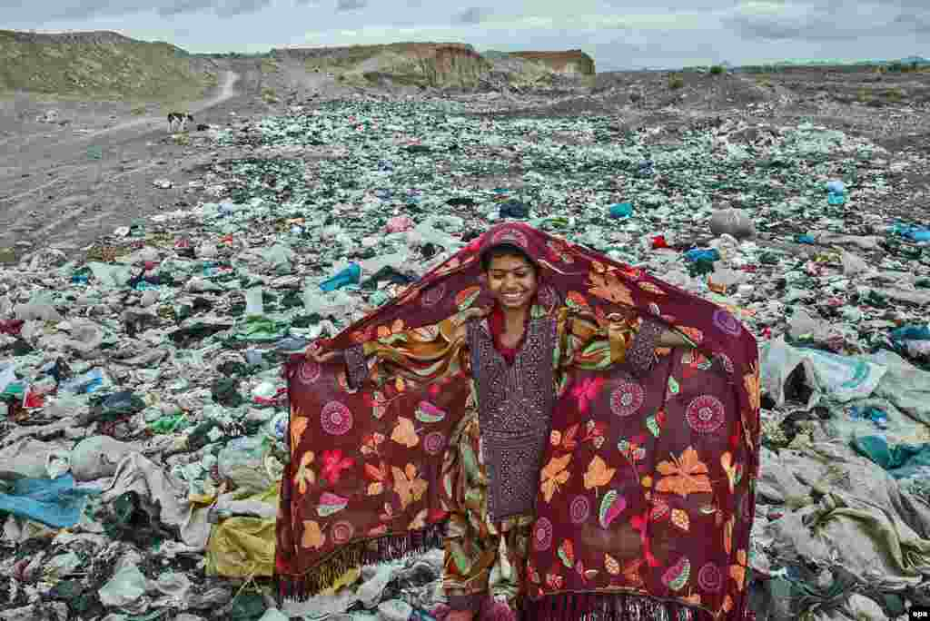 UNICEF's Photo Of The Year 2016 was taken by Iranian freelance photographer Arez Ghaderi and shows a girl atop a mountain of trash in Razavi Khorasan Province at an encampment for people of the Balochi tribe.