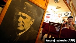 A portrait of Josip Broz Tito, Yugoslavia's former communist leader, is displayed inside a Belgrade nostalgia-themed restaurant.