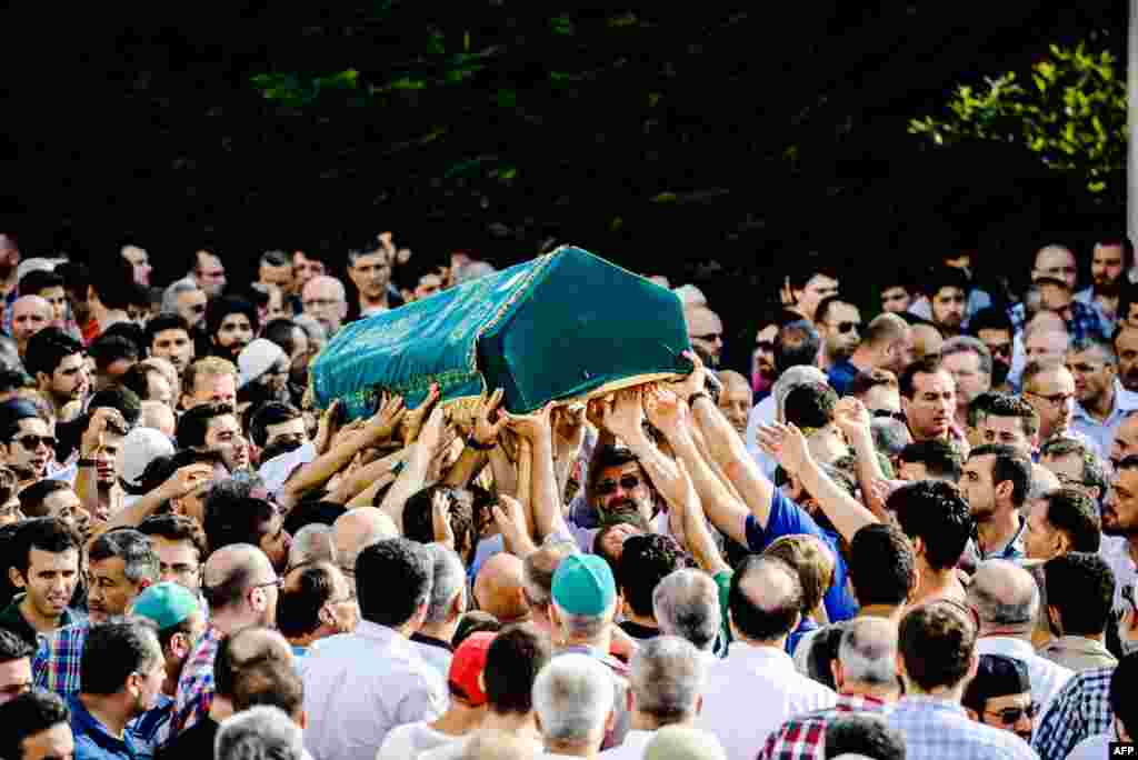 People carry the coffin of Mohammad Eymen Demirci in Istanbul during his funeral, a day after he and 40 others were killed in a suicide bombing and gun attack targeting Istanbul's Ataturk airport. (AFP/Ozan Kose)