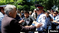 Riot police detain demonstrators in Almaty during a protest against an unpopular land-reform proposal in May 2016. The moratorium was introduced after protests erupted across the country.