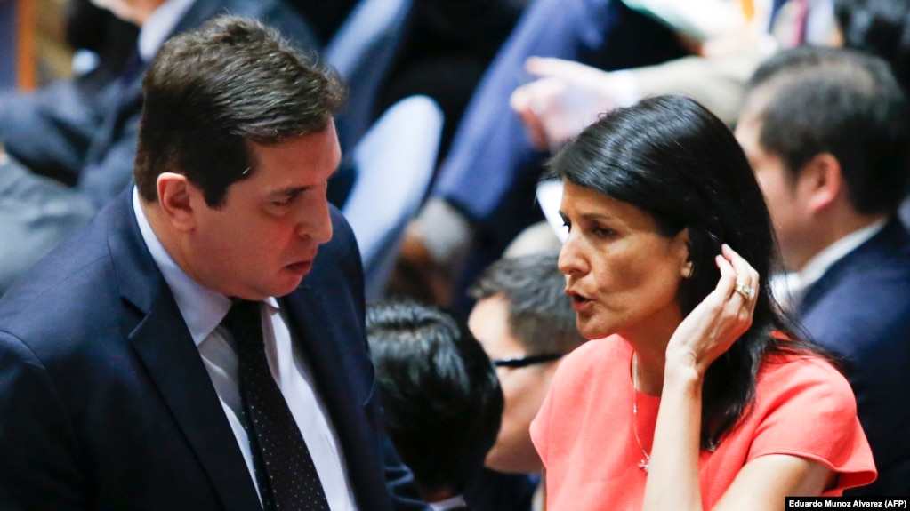 U.S. Ambassador to the United Nations Nikki Haley (right) speaks with Vladimir Safronkov, Russian Deputy UN Ambassador