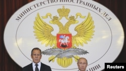 Russia -- President Vladimir Putin (R) and Foreign Minister Sergei Lavrov attend a meeting with Russian ambassadors at the Foreign Ministry headquarters in Moscow, 09Jul2012