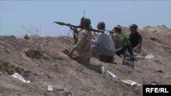 Türkmen meýletinçileri Kerkukda YYDL jeňçilerine garşy söweşýär.