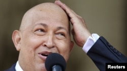 Venezuelan President Hugo Chavez joked about his lack of hair during cancer treatment while talking to reporters at Miraflores Palace in Caracas in 2011.