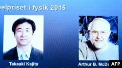 Лауреаты Нобелевской премии 2015 года по физике Такааки Каджита (слева) и Артур Макдональд.