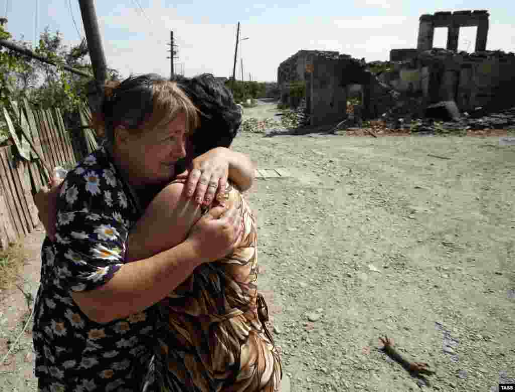 Women embrace amid ruins in Tskhinvali, which was largely destroyed in the fighting.