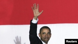 U.S. President Barack Obama waves goodbye after delivering a speech at the University of Jakarta, Indonesia