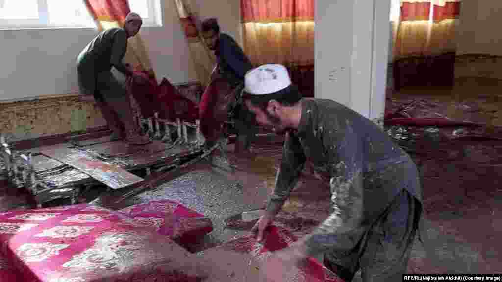 The aftermath of the flood inside a house in Madian Wardak Province on August 26.