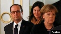 Fransiýanyň prezidenti Fransua Olland (çepde) we Germaniýanyň kansleri Angela Merkel.
