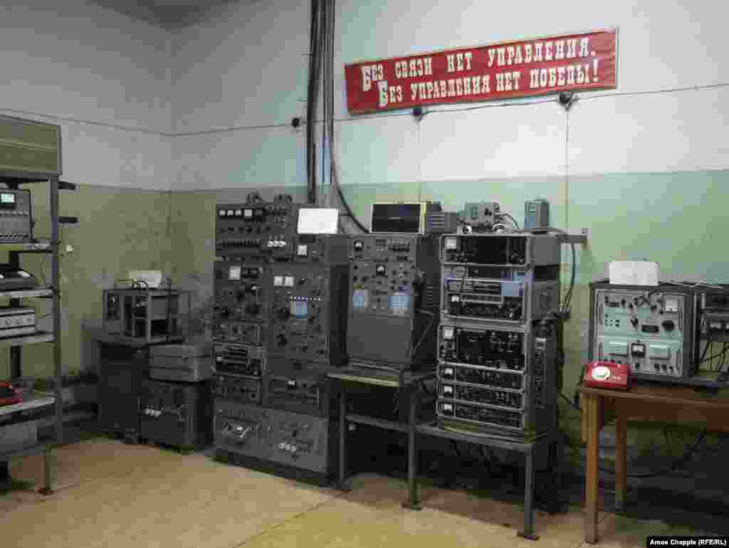 "A communications room links the bunker to other Soviet strongholds, including the Kremlin. The sign reads ""without communication there is no control. Without control, there is no victory!"""
