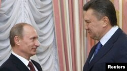 Russian Prime Minister Vladimir Putin (left) and Ukraine's President Viktor Yanukovych -- who will blink first?