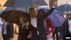 Cuba - President Barack Obama (front) waves upon his arrival to the Cathedral Havana, Cuba, 20 March 2016
