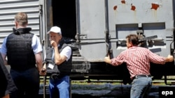 Один из вагонов-рефрижераторов с останками жертв авиакатастрофы