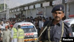 A policeman stands stands guard after an incident in Quetta on May 17, in which five alleged suicide bombers were shot dead by Pakistani security forces.
