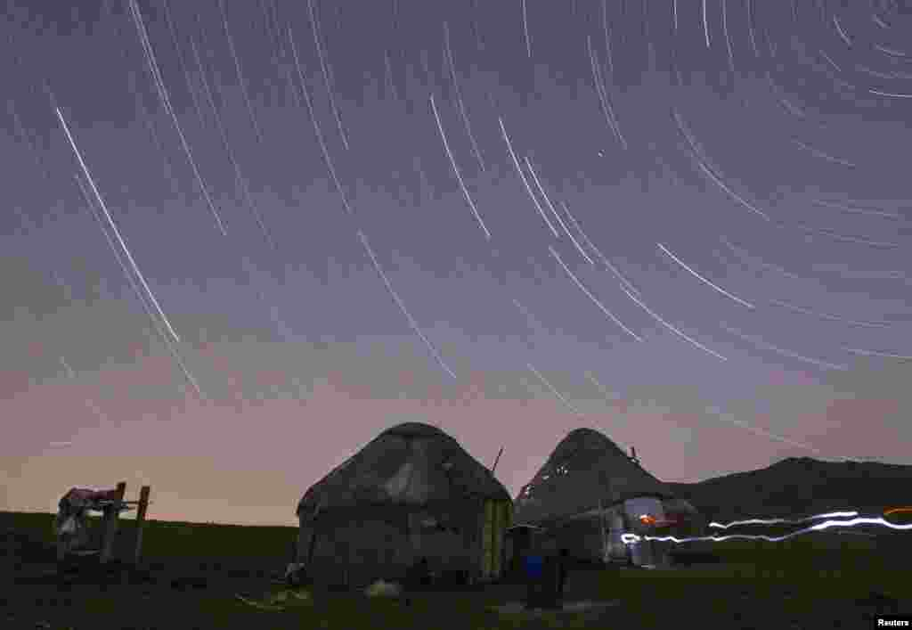 Star trails form over yurts in a long exposure photograph taken on Kazakhstan's Assy plateau, east of Almaty. (Reuters/Shamil Zhumatov)
