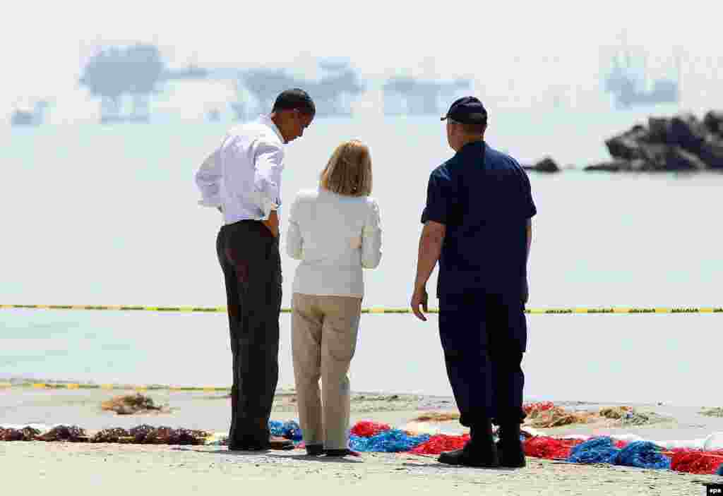 Obama tours the beach in Port Fourchon, Louisiana, on May 28, 2010, after an explosion at BP's Deepwater Horizon offshore drilling rig resulted in the worst oil spill in U.S. history.