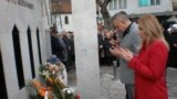 Serbia-- Laying flowers at the Sharampovo Memorial--Prijepolje, 27 February 2020.
