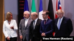 BELGIUM -- Britain's Foreign Secretary Boris Johnson, German Foreign Minister Heiko Maas, French Foreign Minister Jean-Yves Le Drian and EU High Representative for Foreign Affairs Federica Mogherini take part in meeting with Iran's Foreign Minister Mohamm