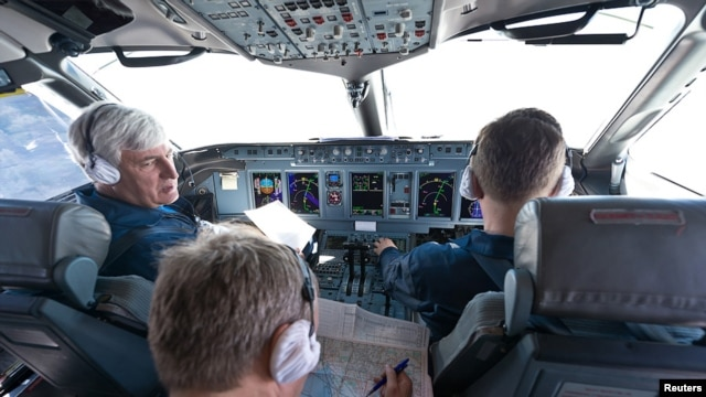 Sukhoi's chief civil test pilot, Aleksandr Yablontsev (left), and his crew sit in the cockpit of a Sukhoi Superjet during a flight on May 8, one day before the deadly crash in Indonesia.