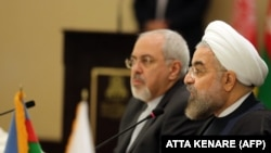 Iranian President Hassan Rouhani (R) and Foreign Minister Mohammad Javad Zarif. File photo