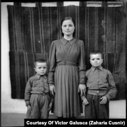 Tamara Cusnir poses with her two younger brothers. She was 16 years old at the time.