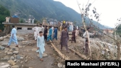 Residents look at the destruction in the aftermath of flash floods in Swat, a district in the northwestern Khyber Pakhtunkhwa Province.