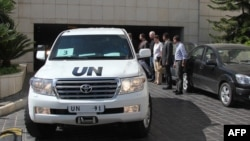 A convoy of United Nations vehicles leaves a hotel in Damascus on August 28 carrying UN inspectors traveling to a site in the Syrian capital of alleged chemical weapons attacks.