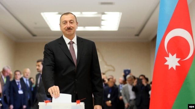 President Ilham Aliyev casts his ballot at a polling station in Baku.