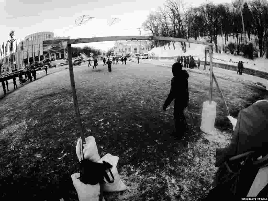 Opposition protesters play soccer on an icy pitch near European Square.