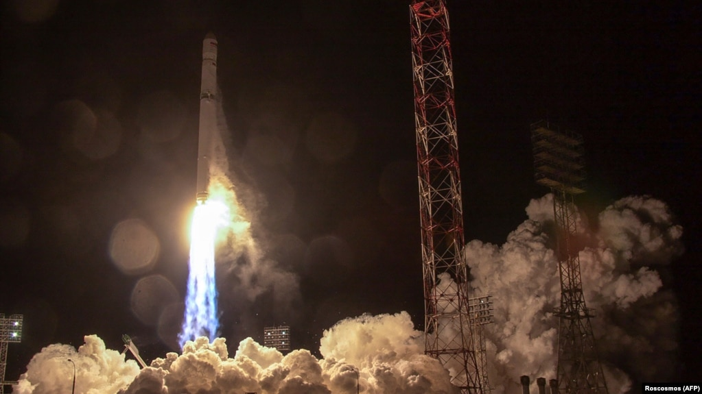 This handout picture provided by Russia's Roscosmos space agency and taken early on December 27 shows a Zenit rocket carrying Angosat-1, the first national telecoms satellite for Angola, lifting off from the launch pad in Kazakhstan.