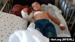 آرشیف، کودک زخم برداشته در نتیجه یک انفجار در کابل