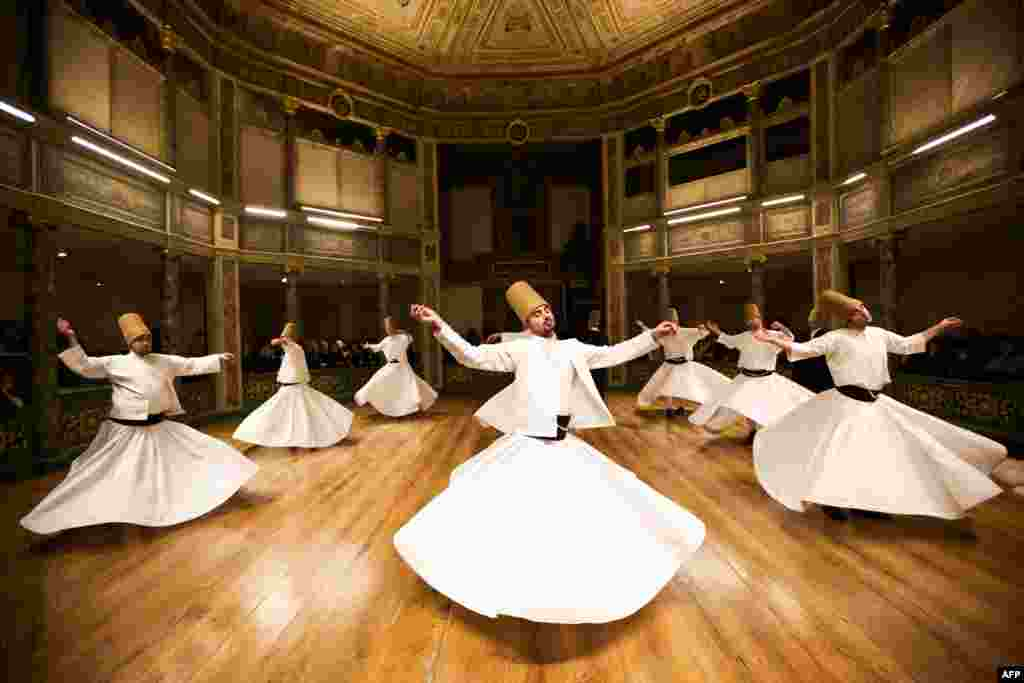 "Whirling dervishes perform at the Galata Mevlevihane (""The Lodge of the Dervishes"") in Istanbul. (AFP/Gurcan Ozturk)"