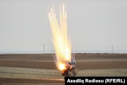 Unexploded ordnance is detonated as part of a clearance operation in the Fuzuli and Cabrayil districts late last year.