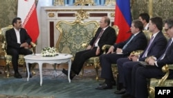 Iranian President Mahmud Ahmadinejad (left) with Russian President Vladimir Putin (second from left) at the Kremlin in Moscow on July 2