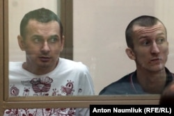 Viktor Medvedchuk says securing the release of jailed Ukrainian film director Oleh Sentsov (left) and Oleksandr Kolchenko (right) may be complicated by the fact that they were convicted of an offense in Crimea, which Russia views as its territory.