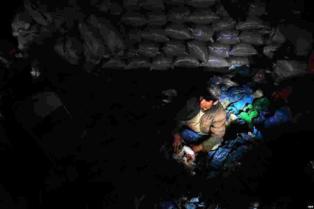 Afghan laborers work at a plastic recycling factory in Mazar-e Sharif on December 17. (epa/Sayed Mustafa)