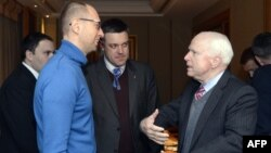 U.S. Senator John McCain (right) speaks to Ukrainian opposition leaders Arseniy Yatsenyuk (left) from and Oleh Tyahnybok during their meeting in Kyiv on December 14.