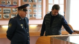 Dmitry Nikolayev (left) is being investigated in cases involving torture.