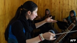 Negina Khpalwak, the first female orchestra conductor in Afghanistan, during a rehearsal at the Afghanistan National Institute of Music in Kabul in January 2017