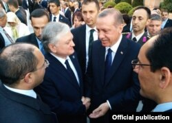 Turkish Prime Minister Recep Tayyip Erdogan (center right) talks to Armenian Foreign Minister Edward Nalbandian during his inauguration in Ankara in August 2014.
