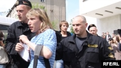 Police arrest participants in the Minsk gay-pride march on May 15.