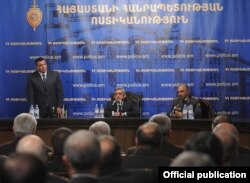 Armenia - President Serzh Sarkisian (C) introduces the newly appointed national police chief, Vladimir Gasparian (L), to senior police officials, 1Nov2011.
