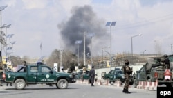 Security forces guard the area as smoke billows from the Sardar Daud Khan's Hospital, also known as Kabul Military Hospital, during an attack by suspected militants in Kabul on March 8.